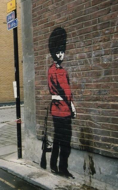 banksy-peeing-policeman